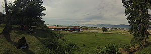 "Lae Airfield - Photo overlooking the old Lae airfield from ""Top Town"" – Lae CBD. At the bottom of the photo is the Amelia Earhart memorial. Photo taken 29 January 2014"