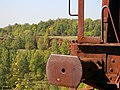Old mining machine takes on colour of earth - panoramio.jpg