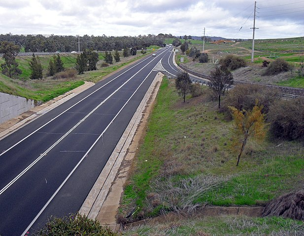 Double Sloid Lines on the Colin Knott Drive/Olympic Highway looking south bound on the Boorooma Street overpass.