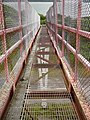 On the Pembrokeshire Coastal Path - Wire mesh footbridge over oil refinery road - geograph.org.uk - 1637370.jpg