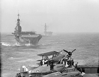 Francis A. Dales - HMS ''Indomitable'' with HMS ''Eagle'' behind her, viewed from the flight deck of HMS ''Victorious''. All three of these aircraft carriers took part in Operation Pedestal.