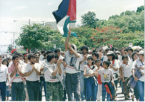 Palestinian Nicaraguan - Palestinians celebrating the 10th anniversary of the Nicaraguan revolution in Managua waving Palestine and Sandinista flags.