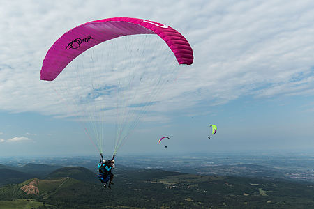 Paragliders on the puy de Dôme, France.