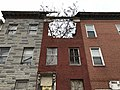 Partial collapse of rowhouse front, 629 W. Lafayette Avenue, Baltimore, MD 21217 (39967231524).jpg