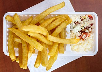 French fries - A patatje speciaal, with frietsaus, curry ketchup or tomato ketchup, and chopped raw onions, is popular in the Netherlands.