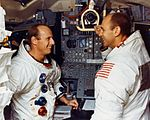 Pete Conrad (left) and Al Bean pose in the LM simulator at the Kennedy Space Center (KSC).jpg