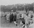 Photograph of President Truman and other dignitaries standing in the rain, reviewing the 442nd Regimental Combat... - NARA - 199388.tif