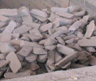 Pig iron - Pig iron of a type used to make ductile iron, stored in a bin