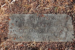 Pink Anderson - Cemetery marker for Anderson in Lincoln Memorial Garden, with a Gibson J-50 guitar and a harmonica