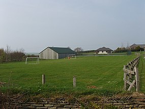 Playing field of holiday cottages, by Box's Shop - geograph.org.uk - 405580.jpg