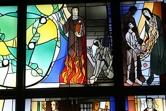 Edith Stein and Maximilian Kolbe, stained glass by Alois Plum in Kassel. The two saints died as prisoners of the Nazis at Auschwitz. Plum Edith Stein und Maximilian Kolbe.JPG