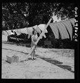Point Pleasant, West Virginia. Mrs. Fergusen putting a pole on the clothes line LCCN2017855344.tif