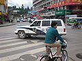 Police SUV turning on Minzhu Road, Lijiang.JPG