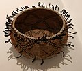 Pomo coiled basket with feathers and shell beads..jpg