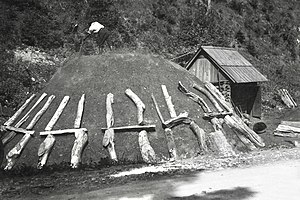 Ćići - The covered wood pile Ćići built for making charcoal. Image from Slovenia.
