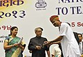 Pranab Mukherjee presenting the National Award for Teachers-2013 to Shri Babu lal Tailor, Rajasthan, on the occasion of the 'Teachers Day', in New Delhi. The Union Minister for Human Resource Development.jpg