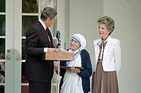 President Ronald Reagan presents Mother Teresa with the Medal of Freedom at a White House Ceremony in the Rose Garden.jpg