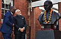 Prime Minister Narendra Modi at a bust of Mahatma Gandhi in South Africa.jpg
