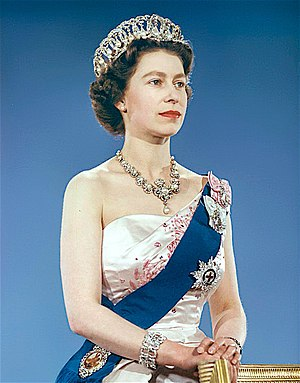 Elizabeth II's jewels - Queen Elizabeth II  in 1959 wearing the Vladimir tiara along with the Queen Victoria Jubilee Necklace, the blue Garter Riband, Badge and Garter Star and the Royal Family Orders of King George V and King George VI.