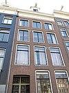 foto van Huis met gevel onder rechte lijst en rondbogige dakkapel