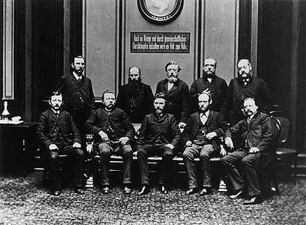 Paul Singer (standing, farthest right) with the Social Democratic Reichstag deputies, 1889 Reichstagsfraktion1889.jpg