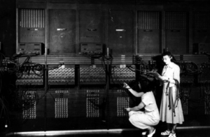 Marlyn Meltzer - Programmers Ruth Lichterman (crouching) and Marlyn Wescoff (standing) wiring the right side of the ENIAC with a new program.