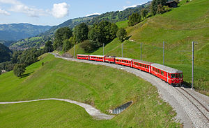 Rhaetian Railway - Ge 4/4 <sup>I</sup> with push–pull train and two extra coaches shortly before arriving in Saas. Küblis is visible in the valley at left.