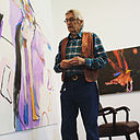 Rick Bartow with his paintings at Froelick Gallery, Portland, Oregon.jpg