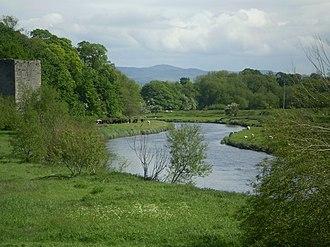 River Clwyd - River Clwyd by Rhuddlan Castle, Moel Famau in distance