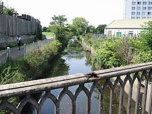 Romford - The River Rom emerges from underground channels at Roneo Corner