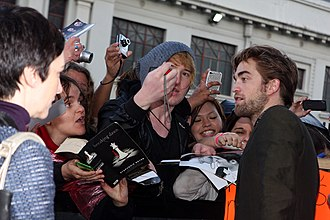 Twilight fandom - Robert Pattinson meets fans at the premiere of Breaking Dawn.