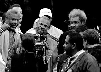 English: Roy Jones, Jr. posing with Don King a...