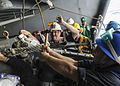 Sailors aboard the USS Theodore Roosevelt secure a fuel probe from INS Shakti during a replenishment-at-sea exercise.JPG