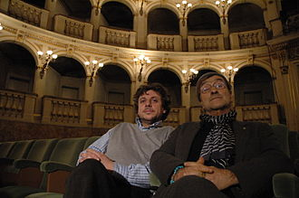 Lucio Dalla - Lucio Dalla (R.) sitting in the Teatro Comunale, in Bologna, next to music producer Gianluigi Salvioni (L.)