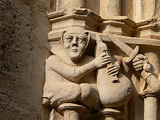 Bagpipes - Medieval bagpiper at the Cistercian monastery of Santes Creus, Catalonia, Spain
