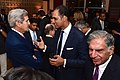 Secretary Kerry speaks with Indian businessman before working dinner in New Delhi.jpg