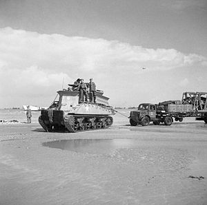 Beach armoured recovery vehicle - Sherman BARV tows a disabled truck and its load off the beach at Normandy, 14 June 1944