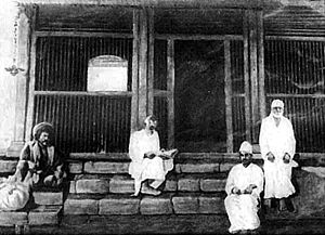Sai Baba of Shirdi - Shirdi Sai Baba (right) and some of his devotees at Dwarakamai, his own Temple.