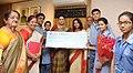 Shri Nand Kishore Aggarwal (Chairman), Ms. Poonam Gupta (Principal) and Ms. Jyoti Aggarwal (PRO) of Maharaja Agarsain Public School, Ashok Vihar, Delhi, handing over a cheque of Prime Minister's Relief Fund for J&K.jpg