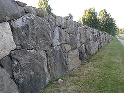Skogskyrkogarden CementeryWall1.jpg