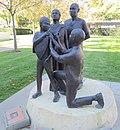 Smallpox vaccination, statue outside the WHO HQ entrance, Geneva.JPG