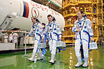 Soyuz TMA-07M crew during the 'fit check'.jpg
