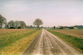Apeldoorn–Zwolle railway - The former railway, currently in use as a bike trail. Near Emst, April 21, 2003.