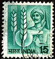 Stamp of India - 1988 - Colnect 1003921 - 1 - Farmer and Agricultural Symbols.jpeg