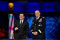 "Stephen Colbert and Army Chief of Staff Gen. Raymond T. Odierno pay tribute to the homecoming troops of the Iraq war with an a cappella rendition of ""I'll Be Home for Christmas"" during the recording of the Colbert Report.jpg"