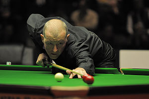 Steve Davis - Davis playing a trick shot exhibition during the break of the 2012 German Masters final