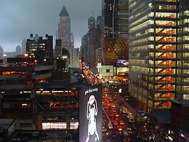 "Eighth Avenue, looking northward (""Uptown""), in the rain; most streets and avenues in Manhattan's grid plan incorporate a one-way traffic configuration Storm at Manhattan.jpg"