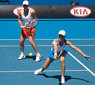 Samantha Stosur - Stosur (left) with doubles partner Rennae Stubbs at the 2009 Australian Open