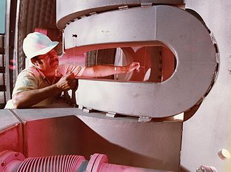 Tandem Mirror Experiment - A worker checks the alignment of part of the shaped baseball coils.