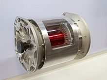 A Complete Tesla Model S Alternating Cur Electric Motor That Has Had Section Removed From The Stator To Show Rotor Inside